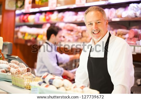 Shopkeepers at work in a grocery store - stock photo