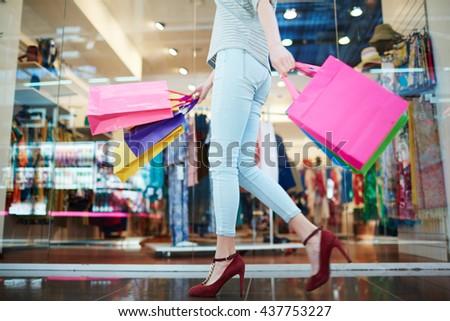 Shopper in casual-wear walking in trade center