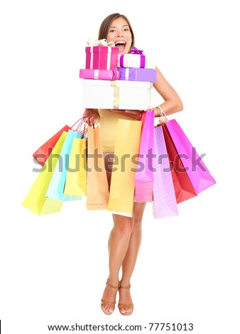 Shopper. Shopaholic shopping woman holding many shopping bags excited. Isolated portrait of young woman in full body on white background. - stock photo