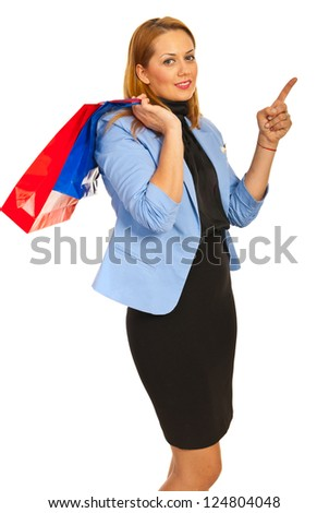 Shopper woman pointing to copy space isolated on white background