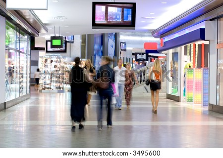 Shoppers at shopping center, motion blur