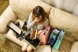 shopping addicted young woman spend too much money worried with empty wallet