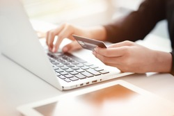 shopping and online payment by using notebook with sun light effect