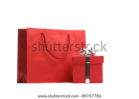 Shopping bag and gift box isolated on white.