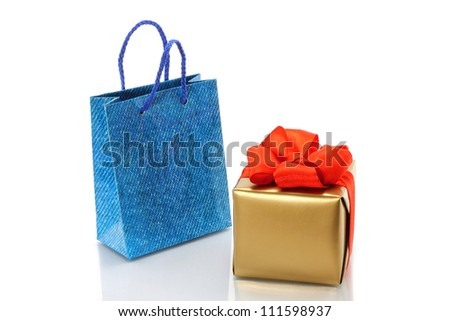 Shopping bag and gold present on a white background