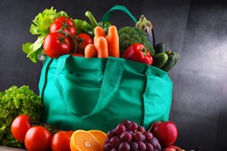 Shopping bag with fresh vegetables and fruits.
