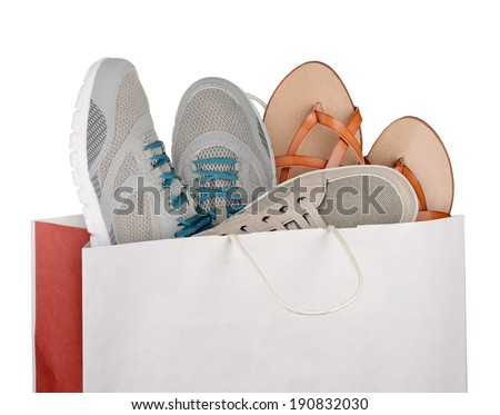 Shopping bag with shoes isolated on white background