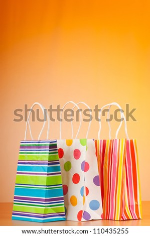 Shopping bags against gradient background