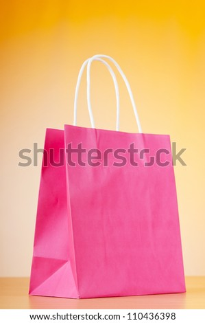 Shopping bags against gradient background - stock photo