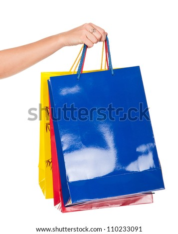 shopping bags set in woman's hand isolated on white