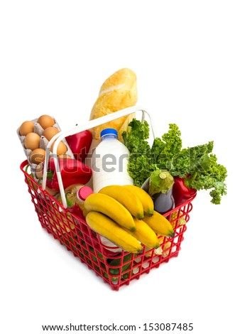 shopping basket full of fresh colorful vegetables,  isolated on white background.