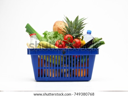 Shopping basket full of vegetables, fruits, bread and milk products on white background.