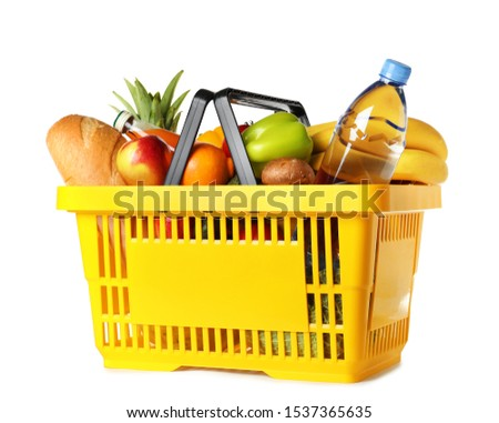 Shopping basket with grocery products on white background Imagine de stoc ©