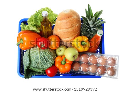 Shopping basket with grocery products on white background, top view Foto stock ©