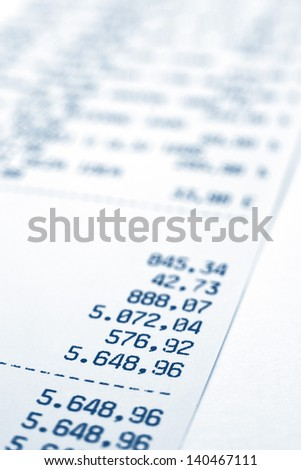 Shopping bill, close up image with shallow depth of field, focus on total amount