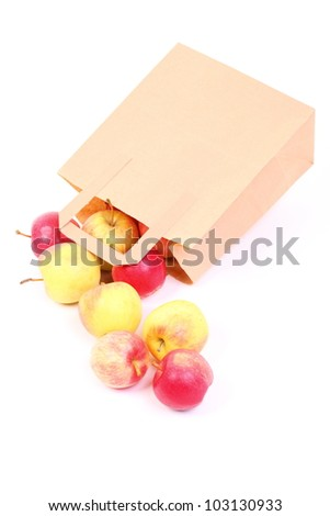 Shopping brown recycle gift bags and red apple isolated on white background