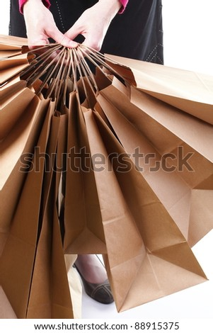 Shopping brown recycle gift bags in woman hand