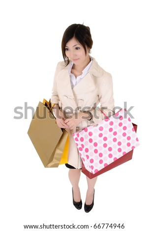 Shopping business woman holding bags and standing, isolated over white bags.