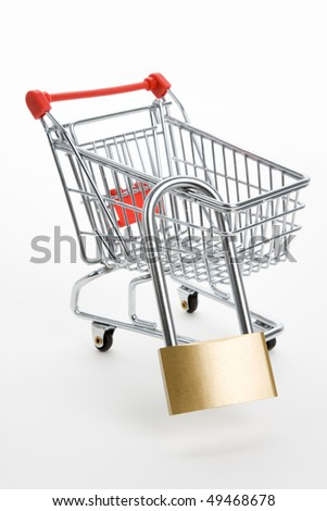 Shopping Cart and lock, Business concept, Tighten budget; - stock photo