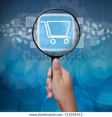 Shopping Cart button in Magnifying glass - stock photo