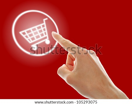 shopping cart button presses by a male hand on red background