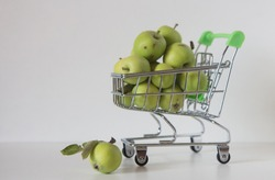 Shopping cart full of apple. Concept of choice.