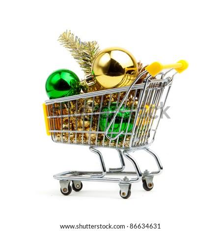 Shopping cart full of  christmas balls  isolated on white background