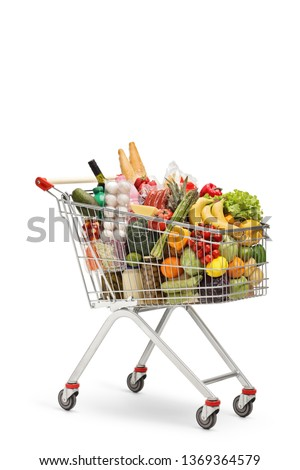 Shopping cart full of food products isolated on white background