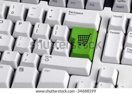 Shopping cart icon button on the enter key of a computer keyboard