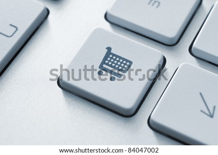 Shopping cart icon on keyboard key. Toned Image.