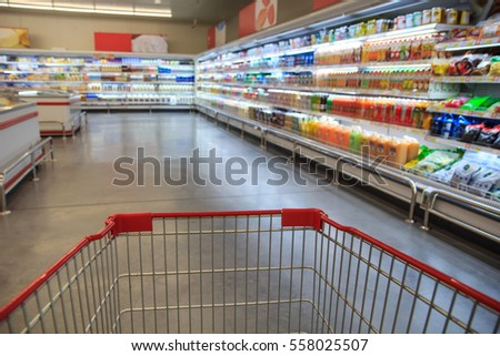 Shopping cart in supermarket. #558025507