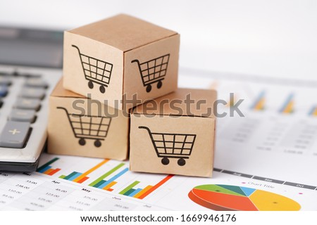 Shopping cart logo on box on chart graph background : Banking Account, Investment Analytic research data economy, trading, Business import export online company concept.