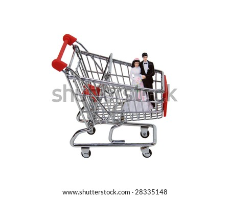 shopping cart made of metal used for carrying groceries holding a bride and a groom path. Black Bedroom Furniture Sets. Home Design Ideas