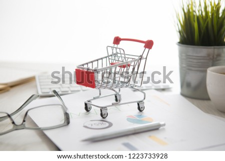 shopping cart on a laptop keyboard. Ideas about e-commerce, e-commerce or electronic commerce is a transaction of buying or selling goods or services online over the internet.