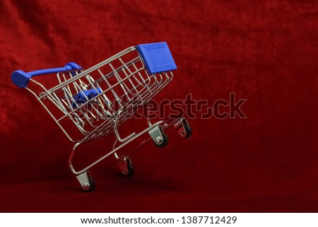 Shopping Cart on Red background, Mini Shopping Cart,  market Cart for Shopping, Empty Shopping Cart. #1387712429
