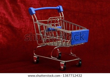 Shopping Cart on Red background, Mini Shopping Cart,  market Cart for Shopping, Empty Shopping Cart. #1387712432