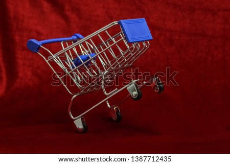 Shopping Cart on Red background, Mini Shopping Cart,  market Cart for Shopping, Empty Shopping Cart. #1387712435
