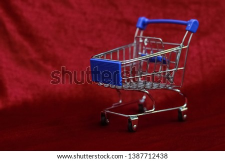 Shopping Cart on Red background, Mini Shopping Cart,  market Cart for Shopping, Empty Shopping Cart. #1387712438