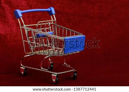 Shopping Cart on Red background, Mini Shopping Cart,  market Cart for Shopping, Empty Shopping Cart. #1387712441