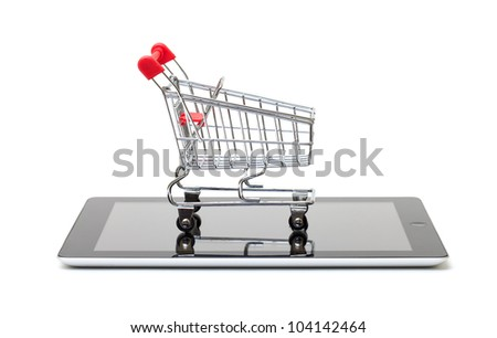 Shopping Cart over a Tablet PC on white background - stock photo