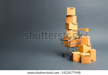 Shopping cart supermarket with boxes. Sales of products. The concept commerce, online shopping. Purchasing power, delivery order. E-commerce, sales and sale of goods through online trading platforms.