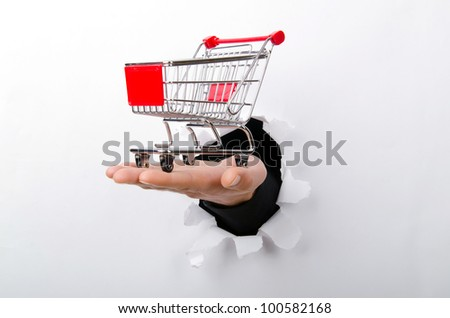 Shopping cart through hole in paper