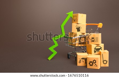 Shopping cart with boxes and green up arrow. Growth trade production, increased sales rate. Improving consumer sentiment. High demand for goods, retail merchandise. Excitement agiotage, rising prices. Foto d'archivio ©