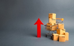 Shopping cart with cardboard boxes and red up arrow. Growth wholesale and retail. Improving consumer sentiment, economic growth. Rising prices for goods, inflation. growth of popularity of the product