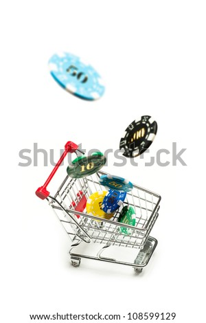 Shopping cart with casino chips fly into it over white