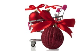Shopping cart with Christmas toys isolated on white background.