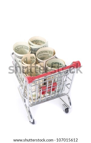 shopping cart with dollar banknotes on white