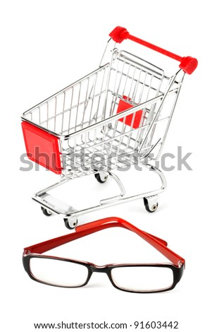Shopping Cart with eye glasses on the white background