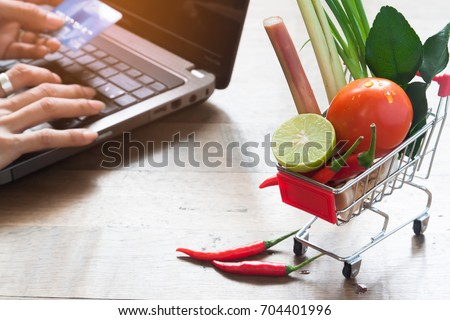 4645d751b6e Shopping cart with full of fresh vegetables from market