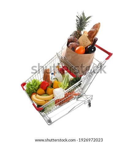 Shopping cart with groceries on white background, above view Сток-фото ©